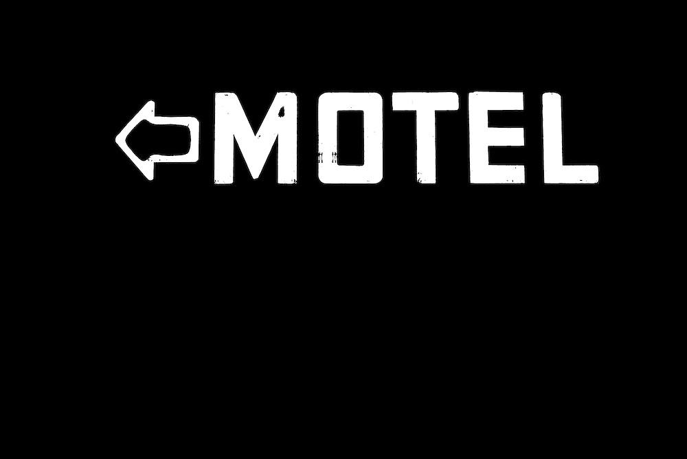 Neon motel sign lit up at night, Walla Walla, Washington.