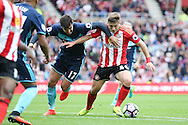 Sunderland forward Lynden Gooch (46)  fights off the attention of Middlesbrough defender Antonio Barragan (17)  during the Premier League match between Sunderland and Middlesbrough at the Stadium Of Light, Sunderland, England on 21 August 2016. Photo by Simon Davies.