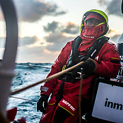 Leg 7 from Auckland to Itajai, day 06 on board MAPFRE, Tamara Echegoyen holding the main sheet at the sunset. 23 March, 2018.