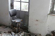 chair at the entrance door in an old abandoned house