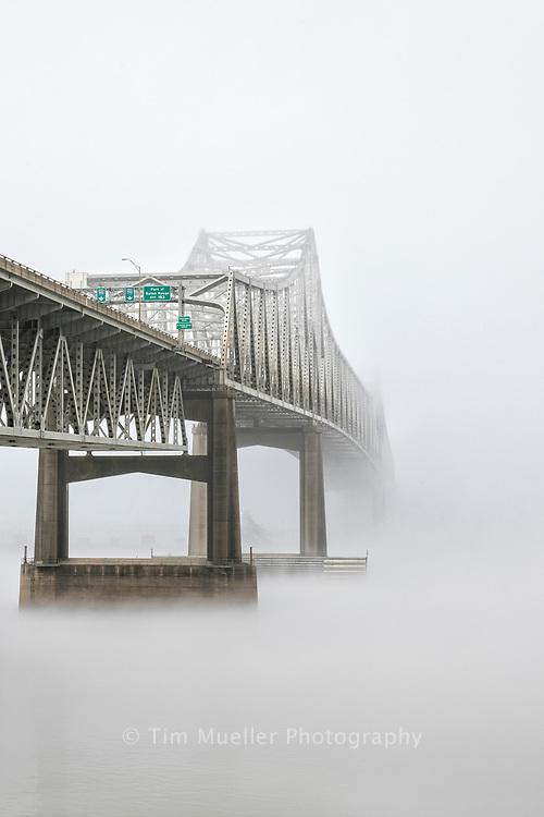 Dense fog obscures the I-10 Mississippi River Bridge near downtown Baton Rouge, Louisiana.