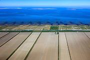 Nederland, Groningen, Gemeente Eemsmond, 01-05-2013; Waddenkust ten noorden van Uithuizen. Landaanwinning met opstrekkende verkaveling. Zicht op Rottumerplaat en Schiermonnikoog (li).<br /> Coast of the Waddensea (North Netherands) Land reclamation and view on isles Rottumerplaat en Schiermonnikoog. luchtfoto (toeslag op standard tarieven)<br /> aerial photo (additional fee required)<br /> copyright foto/photo Siebe Swart