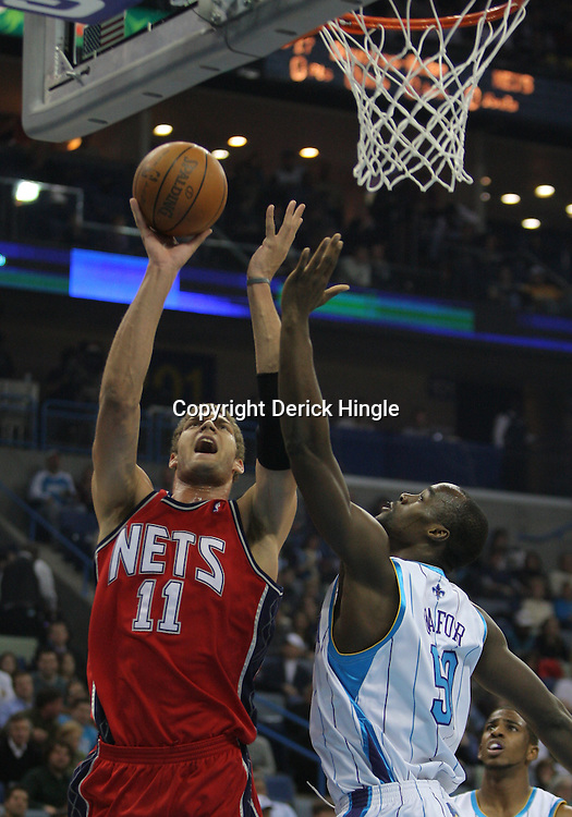 Jan 08, 2010; New Orleans, LA, USA;New Jersey Nets center Brook Lopez (11) shoots over New Orleans Hornets center Emeka Okafor (50) during the first quarter at the New Orleans Arena. Mandatory Credit: Derick E. Hingle-US PRESSWIRE