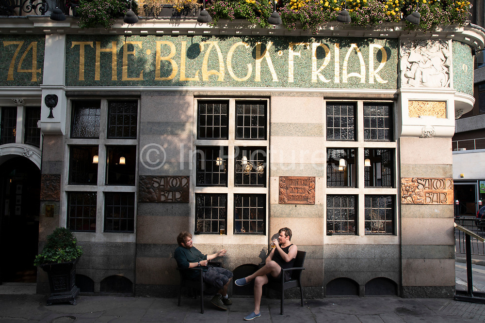 Exterior of The Black Friar pub in London, United Kingdom. The Black Friar is a Grade II listed public house in Blackfriars, London. It was built in about 1875 on the site of a former medieval Dominican friary, and then remodelled in about 1905 by the architect Herbert Fuller-Clark. Much famed for it's internal decoration in an Art Nouveau style. The building was nearly demolished during a phase of redevelopment in the 1960s, until it was saved by a campaign. It is on the Campaign for Real Ales National Inventory of Historic Pub Interiors.