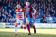 Doncaster Rovers midfielder Herbie Kane (15), on loan from Liverpool shadows Scunthorpe United defender Rory McArdle (23)  during the EFL Sky Bet League 1 match between Scunthorpe United and Doncaster Rovers at Glanford Park, Scunthorpe, England on 23 February 2019.