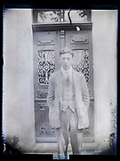 portrait of young adult man standing by the front door France 1926