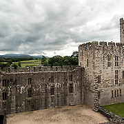 View of some of the interior walls at Caernarfon Castle in northwest Wales. A castle originally stood on the site dating back to the late 11th century, but in the late 13th century King Edward I commissioned a new structure that stands to this day. It has distinctive towers and is one of the best preserved of the series of castles Edward I commissioned.