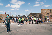 Volunteers gather around the former site of a Wendy's restaurant in the Longfellow neighborhood of Minneapolis, Minnesota on Monday, June 1, 2020. The restaurant was razed to the ground during the civil unrest that overwhelmed the Twin Cities in the final days of May following the death of George Floyd at the hands of Minneapolis Police Department officers.