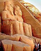 Massive stone statues of Pharaoh Ramesses II decorate the facade of the Great Temple of Abu Simbel on the banks of Lake Nassar up river from the Aswan Dam in Upper Egypt.