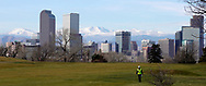 A worker walks down a fairway at the City Park golf course with the downtown city skyline in the background in Denver, Colorado, U.S., November 16, 2017. REUTERS/Rick Wilking
