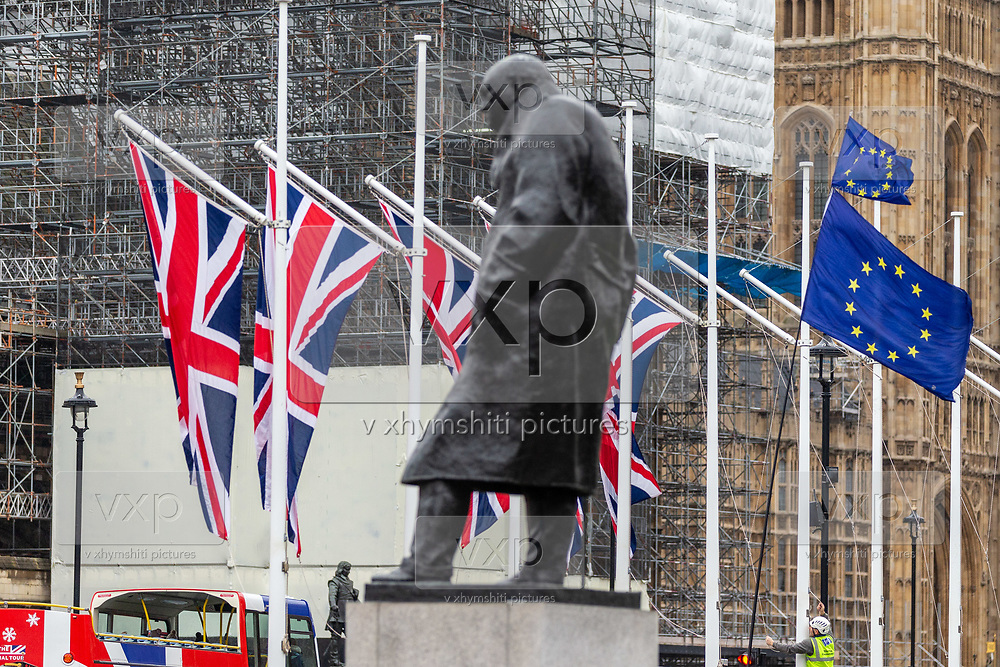 Union flags hang outside Parliament near the statue of Winston Churchill in London, Thursday, Jan. 30, 2020.  (Photo/Vudi Xhymshiti)