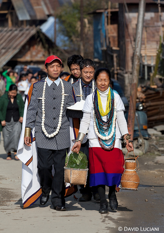 Local Apatani people walking on a small mainstreet in Hari village during Murung festival.