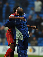 Photo: Paul Greenwood.<br />Man City v Reading. The Barclays Premiership. 03/02/2007. Reading player Andre Bikey celebrates with assistant manager Wally Downes