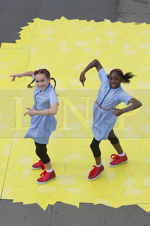 """© Licensed to London News Pictures. 07/08/2013. London, England. L-R: Arizona Snow, 12, and Portia Oti, 11, as Dorothy. ZooNation Dance Company return to the Southbank Centre with the world premiere of """"Groove on Down the Road"""", a hip hop take on the """"Wizard of Oz"""" story. With Portia Oti and Arizona Snow as Dorothy, Michael McNeish as Toto, Jaih Betote Dipito as Scarecrow, Michael Ureta as Tin Man and Corey Culverwell as Lion. Photo credit: Bettina Strenske/LNP"""