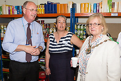 Networking with Cllr Jessamy Blanford, Mayor of Ashford, right, at the opening of FareShare's relocated warehouse in Ashford, Kent. Ashford, Kent, May 23 2019.