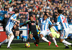 AFC Bournemouth's Jordon Ibe (middle left) battles Huddersfield Town's Rajiv van La Parra for the ball during the Premier League match at the John Smith's Stadium, Huddersfield.
