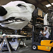Alex from the technical team adjust the position of the head. Aurora is a giant polar bear puppet, the size of a London double decker bus. The bear is the brain child of Greenpeace UK and it will be the center piece in the Greenpeace campaign Save the Arctic  global day of action in London Sept 15th. Aurora is designed by Christopher Kelly in collaboration with props designer Simon Costin and made by Factory Settings in East London.