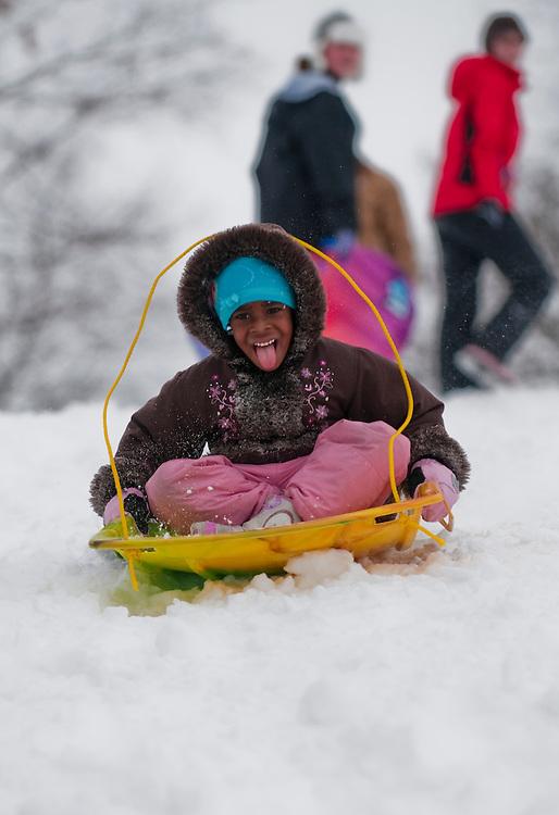 Matt Dixon | The Flint Journal..Elaina Morris, 5, of Flint, enjoys sledding at Mott Park, Monday, Feb. 21.