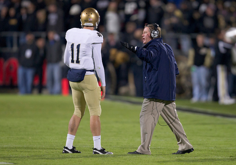 October 01, 2011:  Notre Dame head coach Brian Kelly gives instructions to his quarterback Tommy Rees (#11) during NCAA Football game action between the Notre Dame Fighting Irish and the Purdue Boilermakers at Ross-Ade Stadium in West Lafayette, Indiana.  Notre Dame defeated Purdue 38-10.