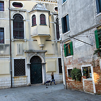 VENICE, ITALY - NOVEMBER 15:  A woman walks by the Levantine Synagogue that was established in 1538 on November 15, 2011 in Venice, Italy. Established in 1516 the Ghetto of Venice was the area were Jews were compelled to live during the Venetian Republic. The English term 'ghetto' is derived from the Venetian term for 'slag' and refers to the refuse left the foundry that was located on the same island. In present times the ghetto is a multi-ethnical area area seen as the cultural heart of the city, but with five synagogues remains the centre of the of Jewish community.
