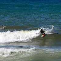 Africa, Morocco, Rabat. Surfer in the waves off Rabat's coast.