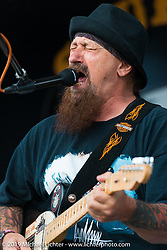 Charlie Brechtel playing his down home biker blues on the Hoyt Axton Stage at the Sturgis Buffalo Chip during the annual Black Hills Motorcycle Rally. SD, USA. August 6, 2014.  Photography ©2014 Michael Lichter.