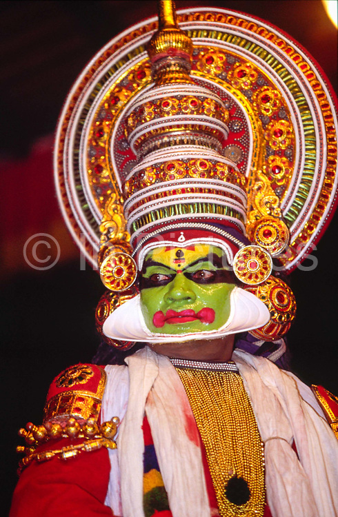 An actor plays a god in a production of the epic, the Ramayana at the Kerala Kalamandalam<br /> The Kalamandalam was founded in 1930 to preserve the cultural traditions of Kathakali, the stylised dance drama of Kerala. Kathakali is the classical dance-drama of Kerala, South India, which dates from the 17th century and is rooted in Hindu mythology. Kathakali is a unique combination of literature, music, painting, acting and dance performed by actors wearing extensive make up and elaborate costume who perform plays which retell in dance form stories from the Hindu epics.