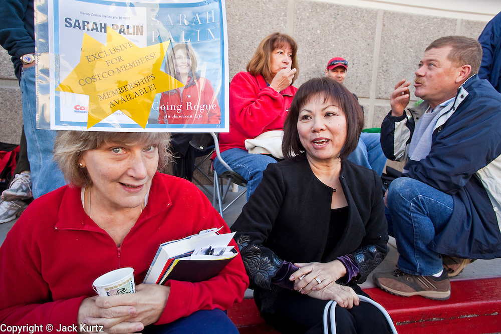 """Dec. 1, 2009 -- TEMPE, AZ: AUDREY BUTKO, left, from Phoenix, and LIEN HENRY, from Laveen, AZ, wait to get Sarah Palin's autograph at the Costco in Tempe Tuesday. Former Alaska Governor Sarah Palin signed copies of her book, """"Going Rogue"""" at a Costco in Tempe, AZ, Tuesday. More than one thousand people showed up for the signing. About 150 of them spent the night at the store. Palin did not make any comments or speak to the address during her appearance in Tempe.  Photo by Jack Kurtz"""