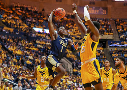 Dec 8, 2018; Morgantown, WV, USA; Pittsburgh Panthers guard Xavier Johnson (1) shoots in the lane during the first half against the West Virginia Mountaineers at WVU Coliseum. Mandatory Credit: Ben Queen-USA TODAY Sports