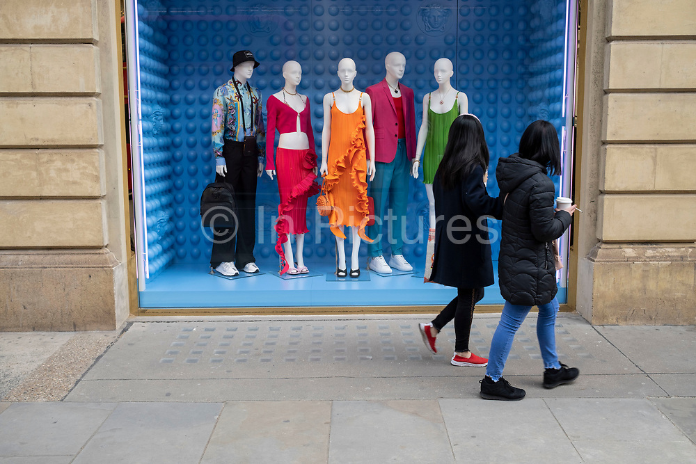 Colourful mannequins shopping window display outside the Versace store in the upmarket area of Knightsbridge on 14th April 2021 in London, United Kingdom. Knightsbridge is one of the principal areas for exclusive, luxury goods in West London. It is known as a district where the rich and wealthy shop, mostly for high end fashion and jewellery.