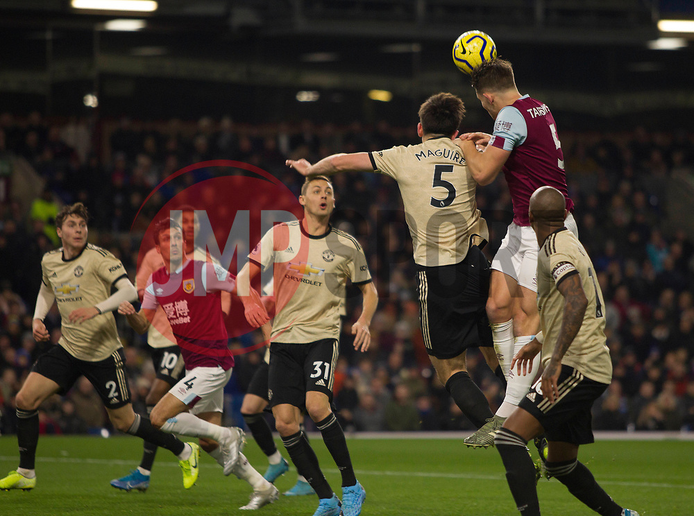 James Tarkowski of Burnley (R) heads at goal - Mandatory by-line: Jack Phillips/JMP - 28/12/2019 - FOOTBALL - Turf Moor - Burnley, England - Burnley v Manchester United - English Premier League
