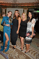 Left to right, JUDE CISSE wife of footballer Djibril Cisse, CHANTELLE TAGOE fiance of footballer Emile Heskey, LEANNE BROWN wife of footballer Wes Brown and SUMI CONNOCK at a birthday dinner for Claire Caudwell for family & friends held at The Dorchester, Park Lane, London on 24th January 2014.