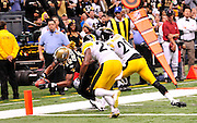 The New Orleans Saints WR Marques Colston (12) reaches out and scores a touchdown to start the second half against the Pittsburgh Steelers. The Saints lead 13-10 in the second half  in New Orleans at the SuperDome in Louisiana on Halloween Oct.31 2010.Photo©SuziAltman.