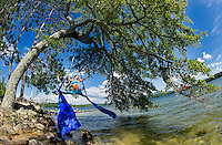 Erin Lovett Sherman performs on aerial silks on Lake Winnipesaukee during her artist in residence with the Sandy Island Family Camp.    (Karen Bobotas/for the Laconia Daily Sun)