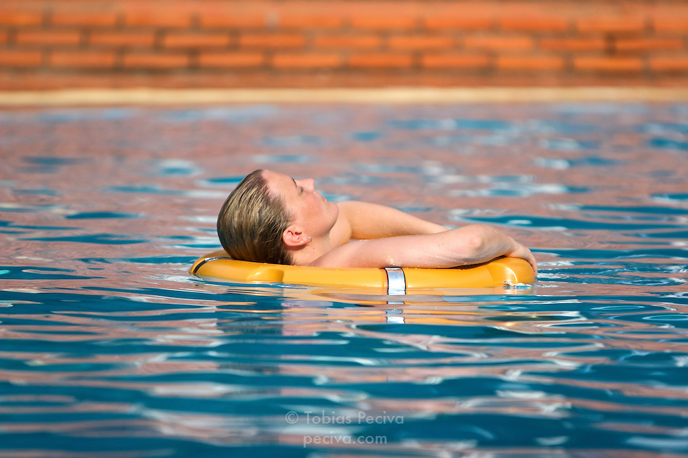 Woman relaxing in a pool at the Saigon Phu Quoc Resort and Spa, on the island of Phu Quoc in southern Vietnam.