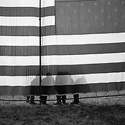 Vietnam Veterans standing by an American flag on the mall on Memorial Day in Washington D.C., USA.<br /> <br /> (Credit Image: © Louie Palu/ZUMA Press)