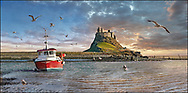Towering Delusions Lindisfarne Castle, mage of the romantic Lindisfarne castle on the majcal Holy Island island at sunset. Lindisfarne is cut off at high tide from the  Nothumberland coastline in nothern England. Remote and unspoilt Lindisfarne is the home of sea birds and seals that come in from the sea every night to rest overnight. by Paul Williams .<br /> <br /> Visit our ENGLAND PHOTO COLLECTIONS for more photos to download or buy as wall art prints https://funkystock.photoshelter.com/gallery-collection/Pictures-Images-of-England-Photos-of-English-Historic-Landmark-Sites/C0000SnAAiGINuEQ .<br /> <br /> Visit our LANDSCAPE PHOTO ART PRINT COLLECTIONS for more wall art photos to browse https://funkystock.photoshelter.com/gallery-collection/Places-Landscape-Photo-art-Prints-by-Photographer-Paul-Williams/C00001WetsxVxNTo