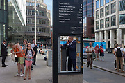 A missing panel in a street directions sign, frames a businessman on his phone, beneath the Monument where the Great Fire of London of 1666 is commemorated exactly 350 years afterwards, on 1st September 2016, in the City of London, England UK.