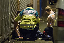 """© Licensed to London News Pictures . 21/10/2012 . Manchester , UK . A male student is tended to by ambulance staff . Students attend a Carnage UK pub crawl at bars in Manchester 's Deansgate Locks with a fancy dress theme of """" Pimps and Hoes """" . The event has been criticised for encouraging binge drinking , sexism and anti-social behaviour . Photo credit : Joel Goodman/LNP"""