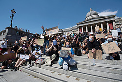 © Licensed to London News Pictures. 31/05/2020. London, UK. Supporters for group Black Lives Matter take part in a kneel in Trafalgar Square for the American George Floyd who died whilst being arrested by US policemen Derek Chauvin. Photo credit: London News Pictures.
