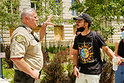 10 JULY 2020 - DES MOINES, IOWA: Polk County Sheriff's Department Captain VANHOOZER argues with MATTHEW BRUCE, a leading member of Black Lives Matter, in front of the Polk County Courthouse. About 75 people, members and supporters of Black Lives Matter gathered at the Polk County Courthouse to protest law enforcement harassment of Black Lives Matter. They also showed support for several members of BLM who made their first appearance in court following their arrest at a BLM protest last week. BLM has become very active in Des Moines in the wake of the police killing of George Floyd in Minneapolis in May.     PHOTO BY JACK KURTZ