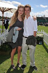 ELIAS HOASE and his sister FRANCESCA HOAREat the 27th annual Cartier International Polo Day featuring the 100th Coronation Cup between England and Brazil held at Guards Polo Club, Windsor Great Park, Berkshire on 24th July 2011.