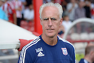 Mick McCarthy, the Ipswich Town manager arrives at the dugout before k/o. Skybet football league Championship match, Brentford v Ipswich Town at Griffin Park in London on Saturday 8th August 2015.<br /> pic by John Patrick Fletcher, Andrew Orchard sports photography.