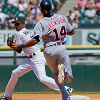 Chicago, IL - June 05, 2011:  White Sox Shortstop, Alexei Ramirez (10), perfoms a double play against the visiting Detroit Tigers at U.S. Cellular Field on June 5, 2011 in Chicago, IL.