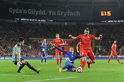 Sam Vokes of Wales is challenged by Ildefons Lima of Andorra - Mandatory byline: Dougie Allward/JMP - 07966 386802 - 13/10/2015 - FOOTBALL - Cardiff City Stadium - Cardiff, Wales - Wales v Andorra - European Qualifier 2016 - Group B