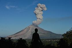 June 15, 2017 - Gundaling, Northern Sumatra, Indonesia -  A person watches Mount Sinabung spewing out volcanic ash in Gundaling village, North Sumatra, Indonesia. Mount Sinabung is one of Indonesia's 129 active volcanoes.  (Credit Image: © Lana Priatna/Xinhua via ZUMA Wire)