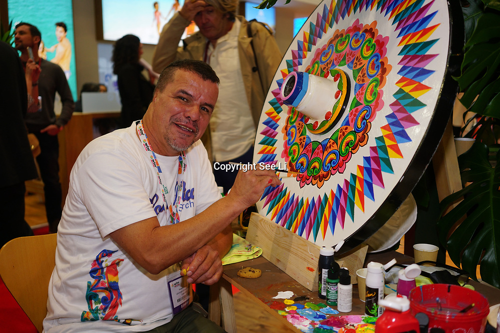 London, England, UK. 7th November 2017.  Costa Rica infamous artist 80% of the arts in the citi of Costa Rica is painted by Rolando Alvarado - Arte Sarchi at the International Travel Trade Show #WTMLDN at Excel London.