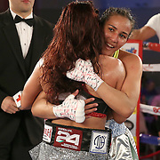 Nydia Feliciano (R) reacts  to the scores as a stunned Noemi Bosques  gasps during a Telemundo Boxeo boxing match at the A La Carte Pavilion on Friday,  March 13, 2015 in Tampa, Florida.  Feliciano won the bout by split decision. (AP Photo/Alex Menendez)