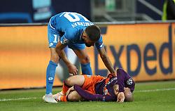 Hoffenheim's Kerem Demirbay tends to Manchester City's David Silva lies injured on the pitch
