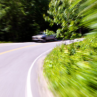 Driving a two lane country road curve in the US state of Maine, near Round Pound along Muscongus Sound.